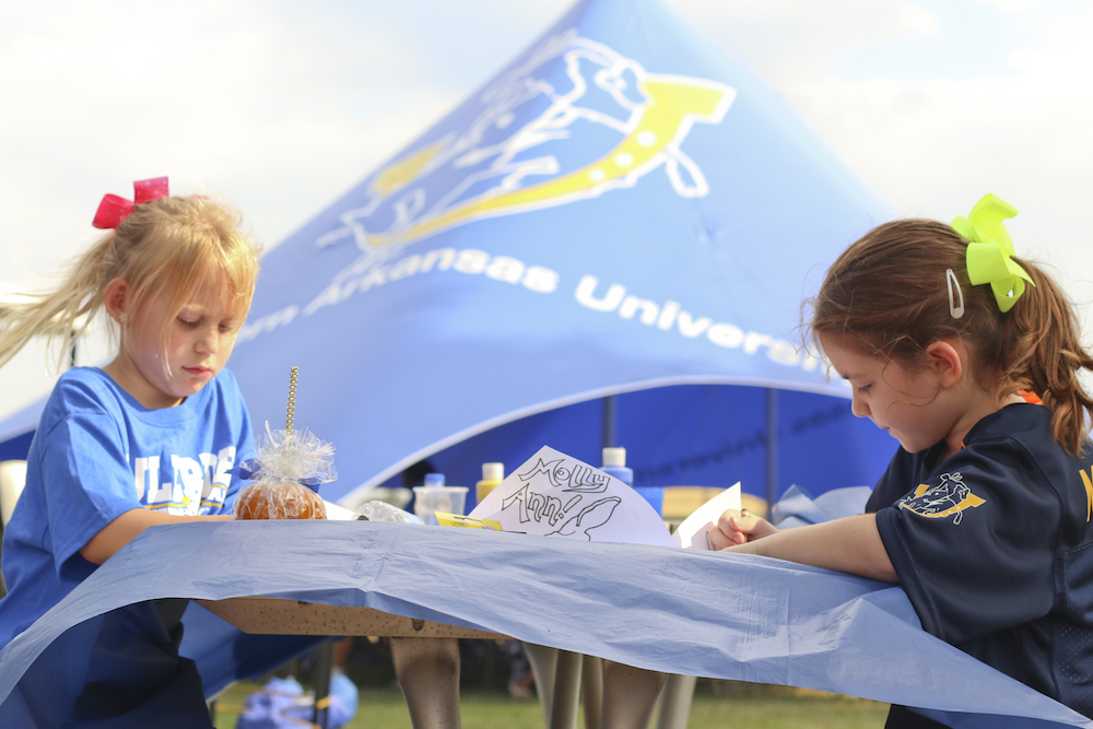 Future Muleriders enjoy face painting and coloring during an SAU Mulegating. Mulegating is sponsored by the SAU Alumni Association.
