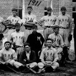 The First Baseball Team. At far right is Coach Hainan Holtzclaw. Players in 1911 and in 1912 included the following men, none identified in this photo: Fred Baskin, Horace L. Buffington, John W. Dawson, Marvin Dudney, Irwin Heath, Thomas Melvin Holt, Conrad Lewis, William Clifford Peace, N. Alton Sawyer, Robert Smith, and Lewis Tate. SAU Archives.