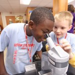 Union elementary students using a microscope