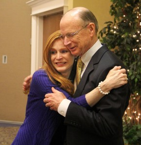 Dr. Rankin is embraced by his daughter, Beth Anne, following his retirement announcement.